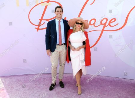 Stock Image of Tom Hawkins and Emma Hawkins pose for photos in the Birdcage on Melbourne Cup Day at Flemington Racecourse in Melbourne, Australia, 05 November 2019.