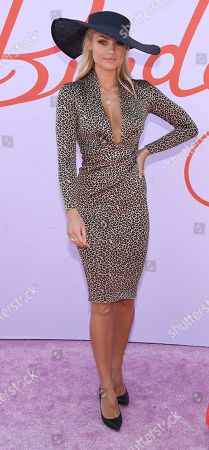 Stock Picture of Elyse Knowles poses for photos in the Birdcage on Melbourne Cup Day at Flemington Racecourse in Melbourne, Australia, 05 November 2019.
