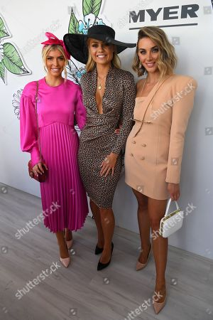 (L-R) Sammy Newton, Elyse Knowles and Brooke Meredith pose for a photo in The Park during Melbourne Cup Day at Flemington Racecourse in Melbourne, Australia, 05 November 2019.
