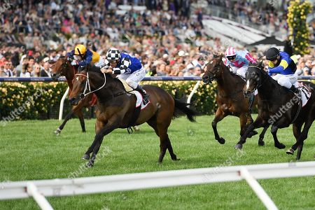 Jockey Damien Oliver (2-L) rides Tactical Advantage to victory in race nine, the MSS Security Sprint, during Melbourne Cup Day at Flemington Racecourse in Melbourne, Australia, 05 November 2019.