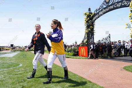Jockeys Jamie Kah and Michelle Payne walk across a field during Melbourne Cup Day at Flemington Racecourse in Melbourne, Australia, 05 November 2019.