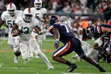 Virginia safety Chris Moore (7) defends Miami running back DeeJay Dallas (13) during the second half of an NCAA college football game, in Miami Gardens, Fla. Miami won 17-9