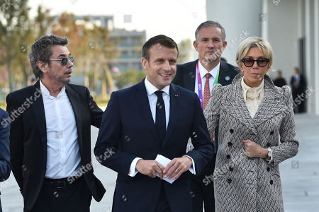 French President Emmanuel Macron (C), First Lady Brigitte Macron (R) and Frwench composer Jean-Michel Jarre (L) arrive to the inauguration of the Centre Pompidou West Bund Museum in Shanghai, China, 05 November 2019.
