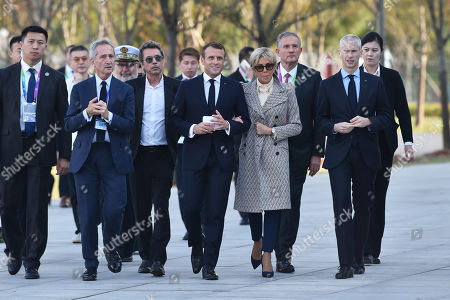French President Emmanuel Macron (C-L), First Lady Brigitte Macron (C-R), French composer Jean-Michel Jarre (3-L) and French Minister of Culture Frank Riester (R) arrive to the inauguration of the Centre Pompidou West Bund Museum in Shanghai, China, 05 November 2019.