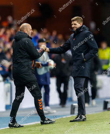 Rangers Manager Steven Gerrard celebrates with Rangers Assistant Manager Gary McAllister after the final whistle