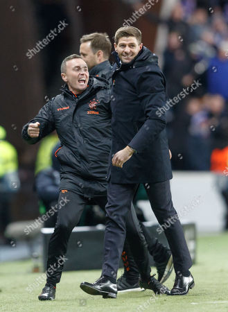 Rangers Manager Steven Gerrard celebrates with First Team coach Tom Culshaw after Steven Davis of Rangers scored to give them a 2-0 lead.