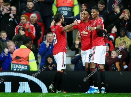 Anthony Martial of Manchester United celebrates scoring a goal to make it 2-0 with Marcus Rashford and Juan Mata