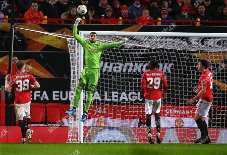 Manchester United goalkeeper Sergio Romero punches the ball clear