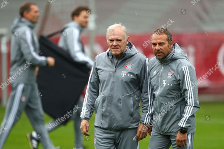 New Bayern Munich head coach Hansi Flick, right, and his assistant Hermann Gerland arrive for a training session prior to the Champions League group B soccer match between Bayern Munich and Olympiakos in Munich, Germany, . Bayern will face Olympiakos on Wednesday