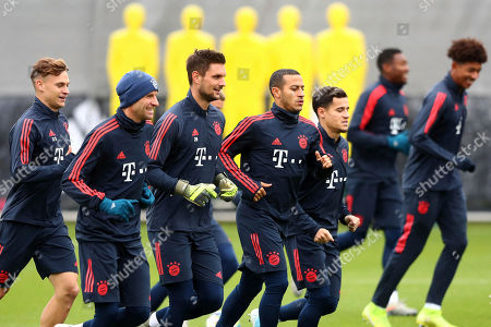 Stock Image of Bayern's Joshua Kimmich, from left, Thomas Mueller, Sven Ulreich, Thiago and Coutinho warm up during a training session prior to the Champions League group B soccer match between Bayern Munich and Olympiakos in Munich, Germany, . Bayern will face Olympiakos on Wednesday
