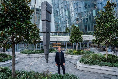 Artist Idris Khan with the 65,000 Photographs artwork