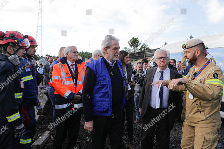 European Commissioner for Humanitarian Aid and Crisis Management, Christos Stylianides (C) together with portuguese minister of Home Affairs Eduardo Cabrita (R) listen to the explanations of a GNR (Republican National Guard) military during the EU MODEX in the Fogueteiro area, near Lisbon, Portugal, 05 November 2019. The EU MODEX exercises, is the first in a new cycle of six large-scale exercises to train the preparation of urban search and rescue intervention teams and medical emergencies.