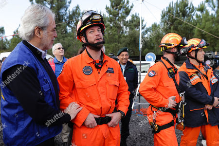 Stock Picture of European Commissioner for Humanitarian Aid and Crisis Management, Christos Stylianides (L) talks with a member of a Netherlands rescue team during the EU MODEX in the Fogueteiro area, near Lisbon, Portugal, 05 November 2019. The EU MODEX exercises, is the first in a new cycle of six large-scale exercises to train the preparation of urban search and rescue intervention teams and medical emergencies.