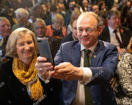 """Deputy Leader of the Liberal Democrats, Ed Davey, does a selfie. Liberal Democrat  Leader, Jo Swinson, launches her party's Election Campaign. The slogan is """"Stop Brexit'. Liberal Democrat Election Launch."""
