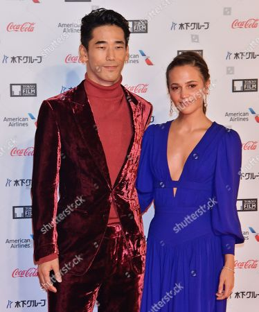 Naoki Kobayashi and Alicia Vikander (R) attend the opening ceremony