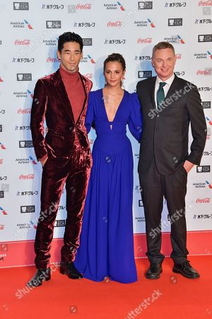(L-R) Naoki Kobayashi, Alicia Vikander and director Wash Westmoreland attend the opening ceremony