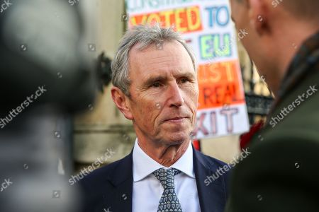 Stock Photo of MP for Ribble Valley and Joint Executive Secretary of the 1922 Committee Nigel Evans speaks with a reporter outside Houses of Parliament in Westminster. A general election will be held on 12 December 2019.