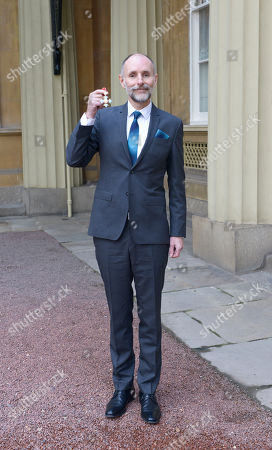 Mr. Glenn Brown, Painter. Receives a CBE for services to Art.