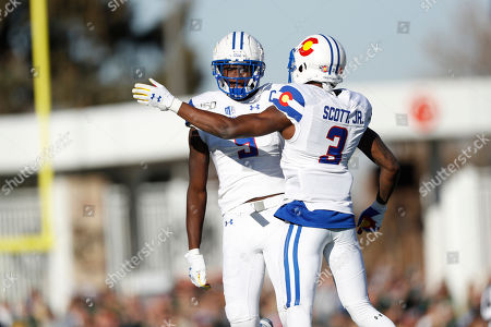 Stock Picture of R m. Colorado State wide receiver Warren Jackson (9) celebrates with Colorado State wide receiver E J Scott (3) after his catch in the second half of an NCAA college football game, in Fort Collins, Colo. Colorado State won 37-17