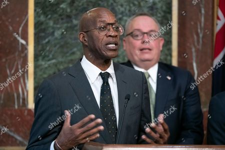 "Edwin Moses speaks at a news conference during a White House event aimed at reforming the World Anti-Doping Agency, in Washington. Formed with good intentions, WADA finds itself at a crossroads as it celebrates its 20th anniversary at a conference this week in Poland. It's an agency riven with conflicts that have hindered its fight against drugs and exacerbated its 4-year-old struggle in the high-profile case against Russia. ""One thing you can't have is built-in interference,"" said Moses, the Olympic champion who serves on WADA's education committee and is also the former chairman of the U.S. Anti-Doping Committee. ""You've got to cut your ties to everything"