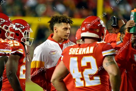 Stock Photo of Kansas City Chiefs quarterback Patrick Mahomes follows the first half of an NFL football game against the Green Bay Packers from the sidelines, in Kansas City, Mo. Starting with Andrew Luck, who retired at age 29 after dealing with a series of injuries, so many star quarterbcks have been hurt that it's hard to keep track of who's confined to the sidelines