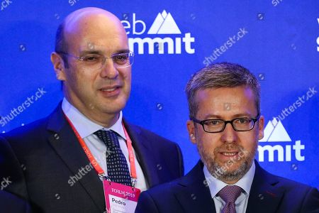 Stock Photo of European Commissioner for Research, Science and Innovation, Carlos Moedas (R) and Portuguese Minister of State for the Economy Digital Transition, Pedro Siza Vieira (L) speak during the second day of the Web Summit in Lisbon, Portugal, 05 November 2019. More the 70,000 participants from 163 countries participate in the 2019 Web Summit, considered the largest event of startups and technological entrepreneur ship in the world, takes place from 04 to 07 November.