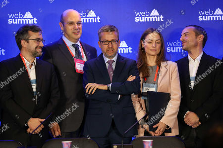 Stock Picture of European Commissioner for Research, Science and Innovation, Carlos Moedas (C) and Portuguese Minister of State for the Economy Digital Transition, Pedro Siza Vieira (2L) speaks during the second day of the Web Summit in Lisbon, Portugal, 05 November 2019. More the 70,000 participants from 163 countries participate in the 2019 Web Summit, considered the largest event of startups and technological entrepreneur ship in the world, takes place from 04 to 07 November.