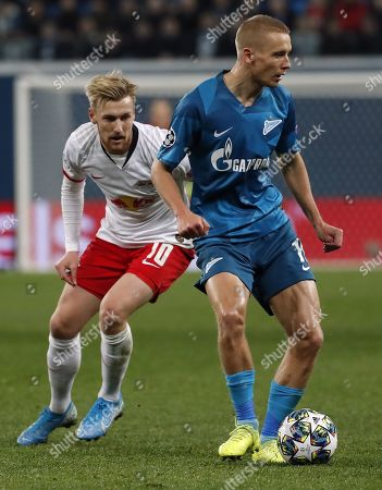 Igor Smolnikov of St.Petersburg (R) in action against Emil Forsberg of RB Leipzig during the UEFA Champions League Group G match between Zenit St.Petersburg and RB Leipzig in St.Petersburg, Russia, 05 November 2019.