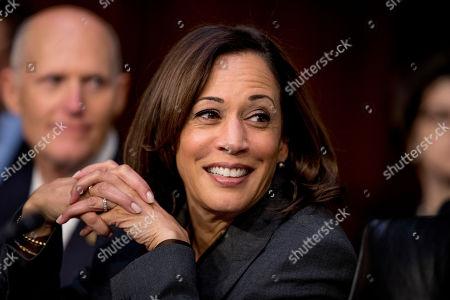 Kamala Harris, Rick Scott. Democratic presidential candidate Sen. Kamala Harris, D-Calif., right, and Sen. Rick Scott, R-Fla., left, appear for a Senate Homeland Security Committee hearing on Capitol Hill in Washington