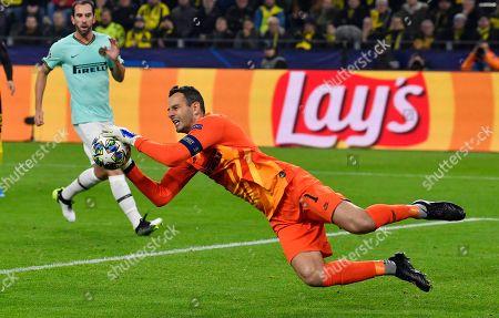 Inter Milan's goalkeeper Samir Handanovic saves during the Champions League group F soccer match between Borussia Dortmund and Inter Milan, in Dortmund, Germany