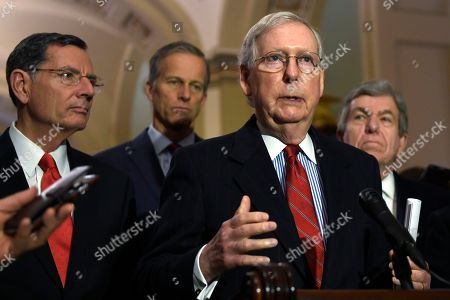 Stock Image of Mitch McConnell, John Barrasso, John Thune, Roy Blunt. Senate Majority Leader Mitch McConnell of Ky., second from right, speaks to reporters on Capitol Hill in Washington,. He is joined by, from left, Sen. John Barrasso, R-Wyo., Sen. John Thune, R-S.D., and Sen. Roy Blunt, R-Mo