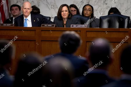 Democratic presidential candidate Sen. Kamala Harris, D-Calif., center, questions FBI Director Christopher Wray, foreground center, during a Senate Homeland Security Committee hearing on Capitol Hill in Washington,. Also pictured is Sen. Rick Scott, R-Fla., left
