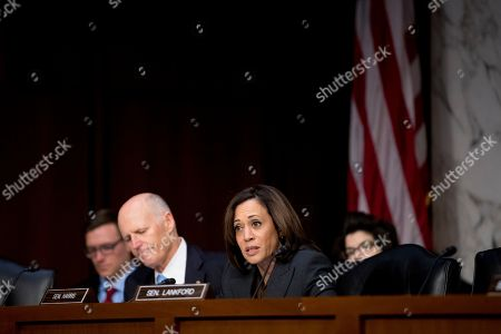 Democratic presidential candidate Sen. Kamala Harris, D-Calif., right, questions FBI Director Christopher Wray during a Senate Homeland Security Committee hearing on Capitol Hill in Washington,. Also pictured is Sen. Rick Scott, R-Fla., left