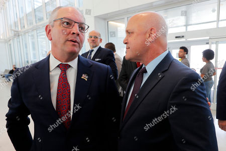 Louisiana Gov. John Bel Edwards, left, talks with former New Orleans Mayor Mitch Landrieu before a ribbon cutting ceremony for the opening the newly built main terminal of the Louis Armstrong New Orleans International Airport in Baton Rouge, La