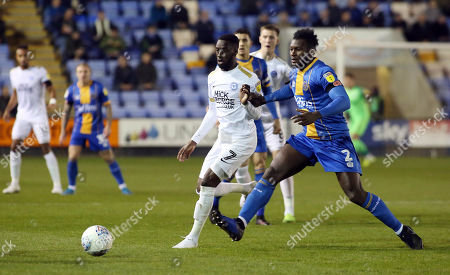 Mohamed Eisa of Peterborough United in action with Aaron Pierre of Shrewsbury Town