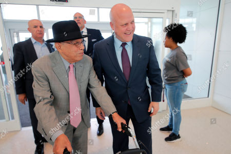 Former New Orleans Mayor Mitch Landrieu, right, greets Dr. Norman C. Francis, former President of Xavier University of Louisiana, as he arrives at a ribbon cutting ceremony for the opening the newly built main terminal of the Louis Armstrong New Orleans International Airport in Baton Rouge, La