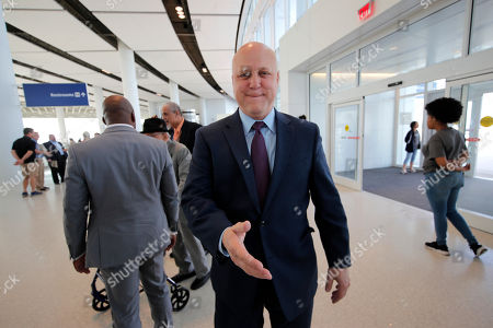 Former New Orleans Mayor Mitch Landrieu arrives for a ribbon cutting ceremony to commemorate the opening the newly built main terminal of the Louis Armstrong New Orleans International Airport in Baton Rouge, La.,. Landrieu's administration was behind the efforts to build the new terminal, although it was not completed during his last term in office