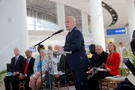 Former New Orleans Mayor Mitch Landrieu, left, speaks at a ribbon cutting ceremony for the opening the newly built main terminal of the Louis Armstrong New Orleans International Airport in Baton Rouge, La