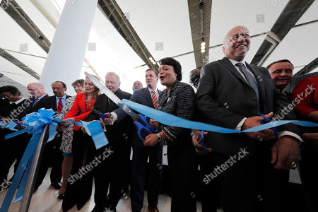 New Orleans Mayor Latoya Cantrell participates in a ribbon cutting ceremony with other dignitaries for the opening the newly built main terminal of the Louis Armstrong New Orleans International Airport in Kenner, La