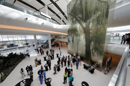 People have refreshments during festivities for the opening of the newly built main terminal of the Louis Armstrong New Orleans International Airport in Kenner, La