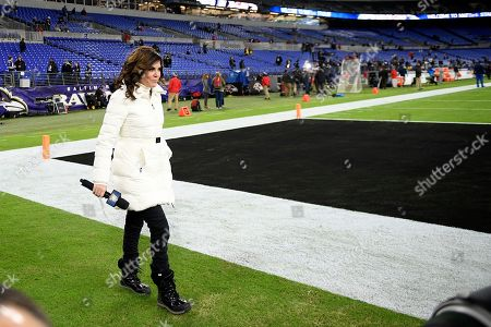 Broadcast reporter Michele Tafoya walks on the field prior to an NFL football game between the New England Patriots and the Baltimore Ravens, in Baltimore