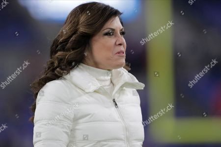 Broadcast reporter Michele Tafoya looks on prior to an NFL football game between the Baltimore Ravens and the New England Patriots, in Baltimore