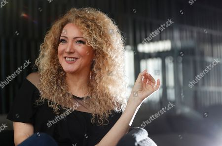 "Panamanian singer and songwriter Erika Ender smiles as she speaks during an interview with The Associated Press in Miami. Even though Ender shot to fame after writing the mega-hit ""Despacito"" with Luis Fonsi, she already had a prolific 20-year career"