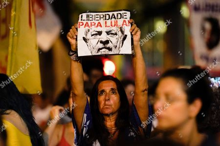 "Stock Image of A woman holds up a sign that reads in Portuguese ""Freedom for Lula,"" referring to former jailed president Luis Inacio ""Lula"" da Silva, during a protest against Brazil's president Jair Bolsonaro to demand an investigation into the 2018 murder of city councilwoman Marielle Franco in Rio de Janeiro, Brazil, . The protests come after a TV Globo report that says a doorman linked President Bolsonaro's name to the killers of Rio councilwoman Marielle Franco"