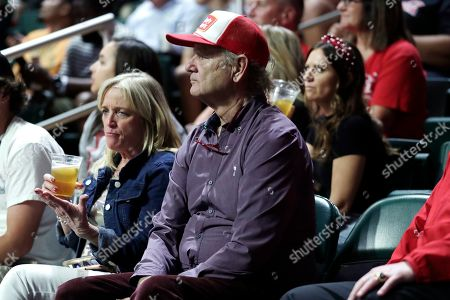 Actor Bill Murray watches during an NCAA college basketball game between Louisville and Miami, in Coral Gables, Fla. Louisville won 87-74. Murray's son Luke Murray is an assistant coach for Louisville