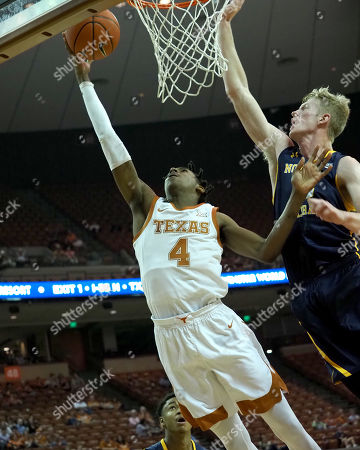 Donovan Williams #4 of the Texas Longhorns in action vs the Northern Colorado Bears at the Frank Erwin Center in Austin Texas. Texas defeat Northern Colorado 69-45