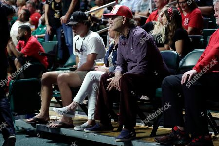 The actor Bill Murray watches during an NCAA college basketball game between Louisville and Miami, in Coral Gables, Fla. Louisville won 87-74. Murray's son Luke Murray is an assistant coach for Louisville