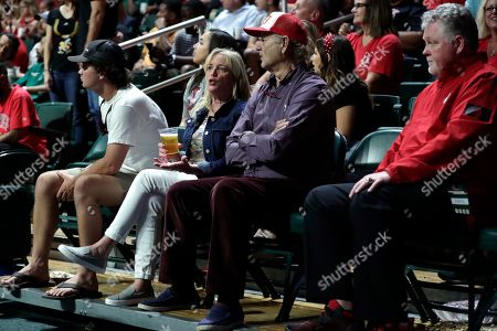 Stock Photo of The actor Bill Murray, center, watches during an NCAA college basketball game between Louisville and Miami, in Coral Gables, Fla. Louisville won 87-74. Murray's son Luke Murray is an assistant coach for Louisville