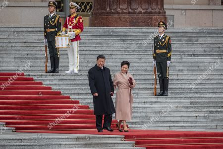 China's President Xi Jinping (C-L) and his wife Peng Liyuan (C-R) arrive for a welcome ceremony for French President Emmanuel Macron at the Great Hall of the People in Beijing, China, 06 November 2019.