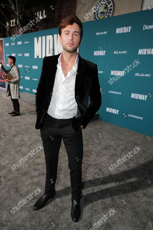 Stock Image of Brandon Sklenar attends the Lionsgate's MIDWAY World Premiere at the Regency Village Theatre in Los Angeles, CA on November 5, 2019.